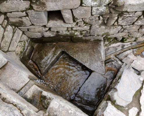 Brunnen in Machu Picchu